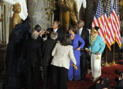 President Obama participate in a ceremony unveiling a statue of Rosa Park in Washington