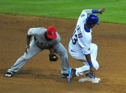 Starlin Castro safely slides into second against Howie Kendrick during the 2011 All-Star game in Phoenix