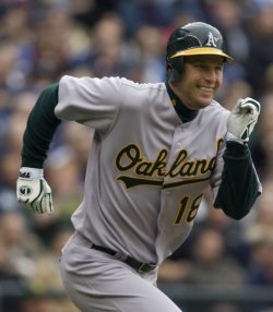 Oakland Athletics Gabe Gross runs to first base in the first inning against the Seattle Mariners
