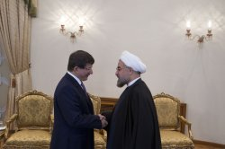 Turkish FM Turkish Foreign Minister Ahmet Davutoglu meets with Iran's president Hassan Rouhani at presidential palace in Tehran, Iran
