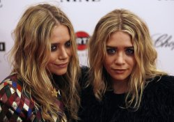 """Actress Mary-Kate Olsen and Ashley Olsen arrive on the red carpet for the Premiere of """"Nine"""" at the Ziegfeld Theater in New York"""