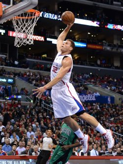 Los Angeles Clippers Blake Griffin dunks over Boston Celtics in Los Angeles