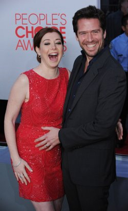Alyson Hannigan and Alexis Denisof attend the 38th annual People's Choice Awards in Los Angeles