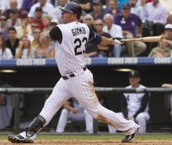 Rockies Giambi Hits Against the Cardinals in Denver