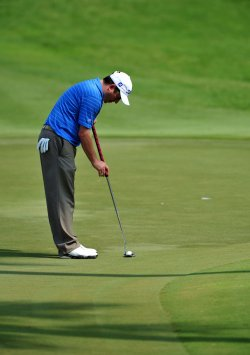 Tim Clark putts on the 16th green during the TPC Players in Florida