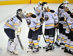 The Buffalo Sabers congratulate goalie Ryan Miller in Washington