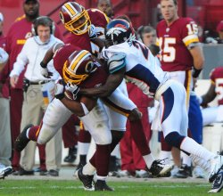Redskins' Ladell Betts runs against the Broncos in Washington