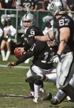 Raiders holder Shane Lechler throws a TD pass in Oakland, California
