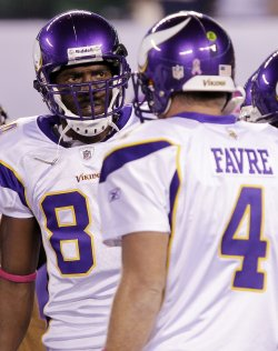 Minnesota Vikings Randy Moss stands in the huddle with Brett Favre at New Meadowlands Stadium in New Jersey