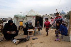 Palestinians Live in Tent Shelter in Gaza