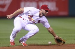St. Louis Cardinals shortstop Paul DeJong can't make play