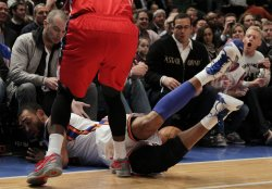 New York Knicks Jared Jeffries falls into the front row at Madison Square Garden in New York
