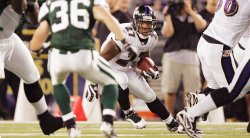 Baltimore Raven's Donald Strickland makes a run for yards against Jets