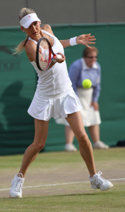 Kournikova plays a forehand at the Wimbledon Championships