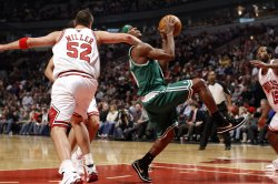 Bulls' Miller fouls Celtics' Rondo in Chicago