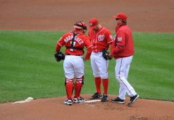 Nationals pitcher Jason Marquis talks with Ivan Rodriguez and Steve McCatty in Washington