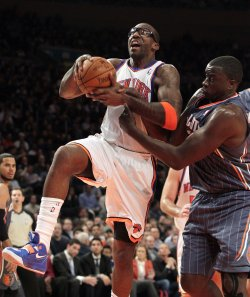 Charlotte Bobcats DeSagana Diop grabs the arm of New York Knicks Amar'e Stoudemire at Madison Square Garden in New York