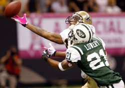 Robert Meachem and Dwight Lowery battle for the ball durng the match up between the New York Jets and New Orleans Saints.