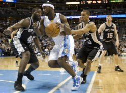 Nuggets Guard Lawson Drives on Spurs Blair and Hill in Denver
