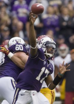 Washington Huskies quarterback Keith Prices passes against the USC Trojans defense at CenturyLink Field in Seattle