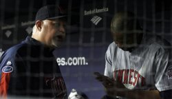 Minnesota Twins manager Ron Gardenhire talks to Minnesota Twins relief pitcher Francisco Liriano in the dug out in the seventh inning against the New York Yankees in game 1 of the ALDS at Yankee Stadium in New York