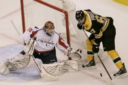 Bruins Pouliot attempts shot on Capitals Holtby in third period at TD Garden in Boston, MA.