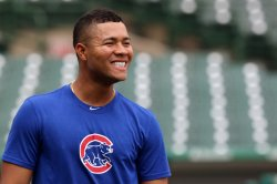 Cubs Quintana shares a smile with former team