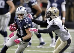 Cowboys wide receiver Cole Beasley goes for 15 yards