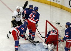 Pittsburgh Penguins Sidney Crosby reacts when Matt Cooke scores a goal at Madison Square Garden in New York