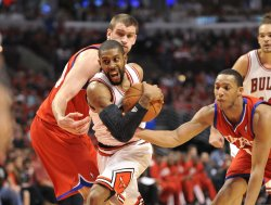 76ers' Turner fouls Bulls Watson during Playoff in Chicago