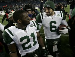Jets Sanchez and Tomlinson celebrate win over Patriots in AFC division playoff at Gillette Stadium in Foxboro, MA.