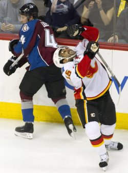 Flames Dawes Takes Stick to the Face in Denver