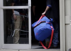 Health officials remove and clean the apartment of Ebola paitent