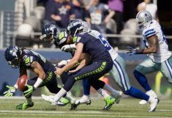 Seattle Seahawks' free safety Earl Thomas, left, recovers a on the kickoff at CenturyLink Field in Seattle.