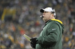 Packers coach McCarthy stands on sidelines at Lambeau Field in Green Bay, Wisconsin