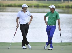 Scott and Manassero stand on the 17th green at 93rd PGA Championship