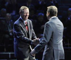 Ford and Mulally shake hands at NAIAS in Detroit