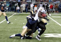 Ravens Ricky Williams is tackled in St. Louis