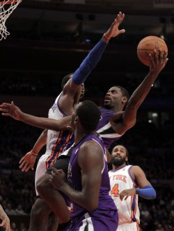New York Knicks Amar'e Stoudemire tries to block a shot from Sacramento Kings Tyreke Evans at Madison Square Garden in New York
