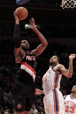 Portland Trail Blazers LaMarcus Aldridge shoots by New York Knicks Wilson Chandler at Madison Square Garden in New York