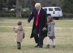 President Trump walks with his grandchldren in Washington