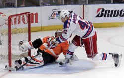 New York Rangers Artem Anisimov scores on Philadelphia Flyers goalie Sergei Bobrovsky at Madison Square Garden in New York