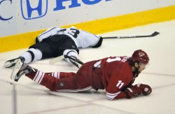 Kings Brown gets boarded by Coyotes Hanzal in Arizona
