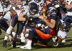 Broncos Tebow Sacked by Bears Defense in Denver