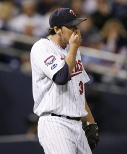 Twins Nathan wipes his face during game 3 of the ALDS in Minneapolis