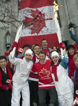 The Olympic torch arrives at Vancouver City Hall on Day 105 of the Vancouver 2010 Winter Olympic Torch Relay