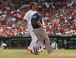Atlanta Braves' Kelly Johnson scores against the St. Louis Cardinals
