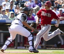 Diamondbacks Pitcher Kennedy Sores Against the Rockies Catcher Olivo in Denver