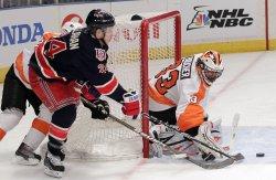 New York Rangers Ryan Callahan tries to slip the puck past Philadelphia Flyers Brian Boucher at Madison Square Garden in New York