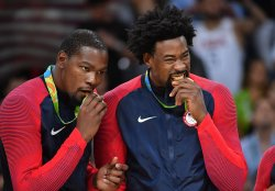 Kevin Durant and DeAndre Jordan celebrate at Rio Olympics